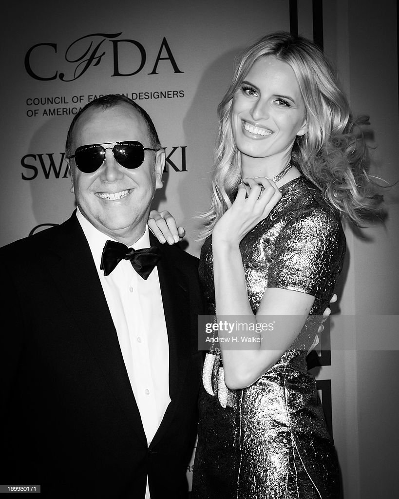 Fashion designer Michael Kors (L) and model <a gi-track='captionPersonalityLinkClicked' href=/galleries/search?phrase=Karolina+Kurkova&family=editorial&specificpeople=202513 ng-click='$event.stopPropagation()'>Karolina Kurkova</a> attend the 2013 CFDA Fashion Awards on June 3, 2013 in New York City.