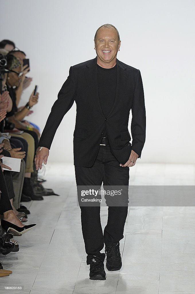 Fashion Designer <a gi-track='captionPersonalityLinkClicked' href=/galleries/search?phrase=Michael+Kors+-+Styliste&family=editorial&specificpeople=4289231 ng-click='$event.stopPropagation()'>Michael Kors</a> walks the runway at the <a gi-track='captionPersonalityLinkClicked' href=/galleries/search?phrase=Michael+Kors+-+Styliste&family=editorial&specificpeople=4289231 ng-click='$event.stopPropagation()'>Michael Kors</a> Spring Summer 2014 fashion show during New York Fashion Week on September 11, 2013 in New York, United States.