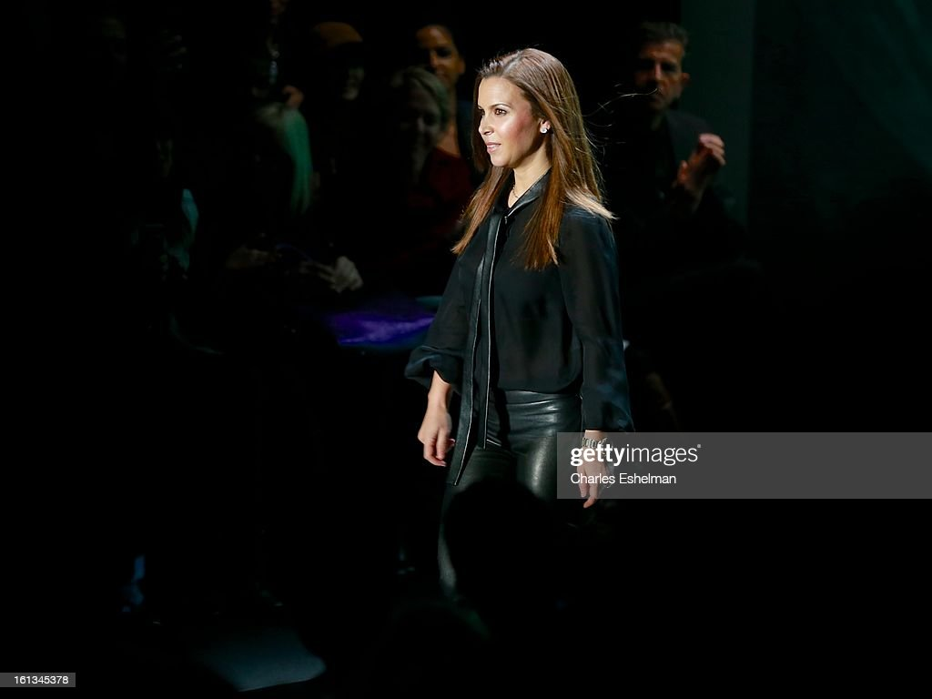 Fashion designer Monique Lhuillier takes a bow at the Monique Lhuillier Fall 2013 Mercedes-Benz Fashion Show at The Theater at Lincoln Center on February 9, 2013 in New York City.