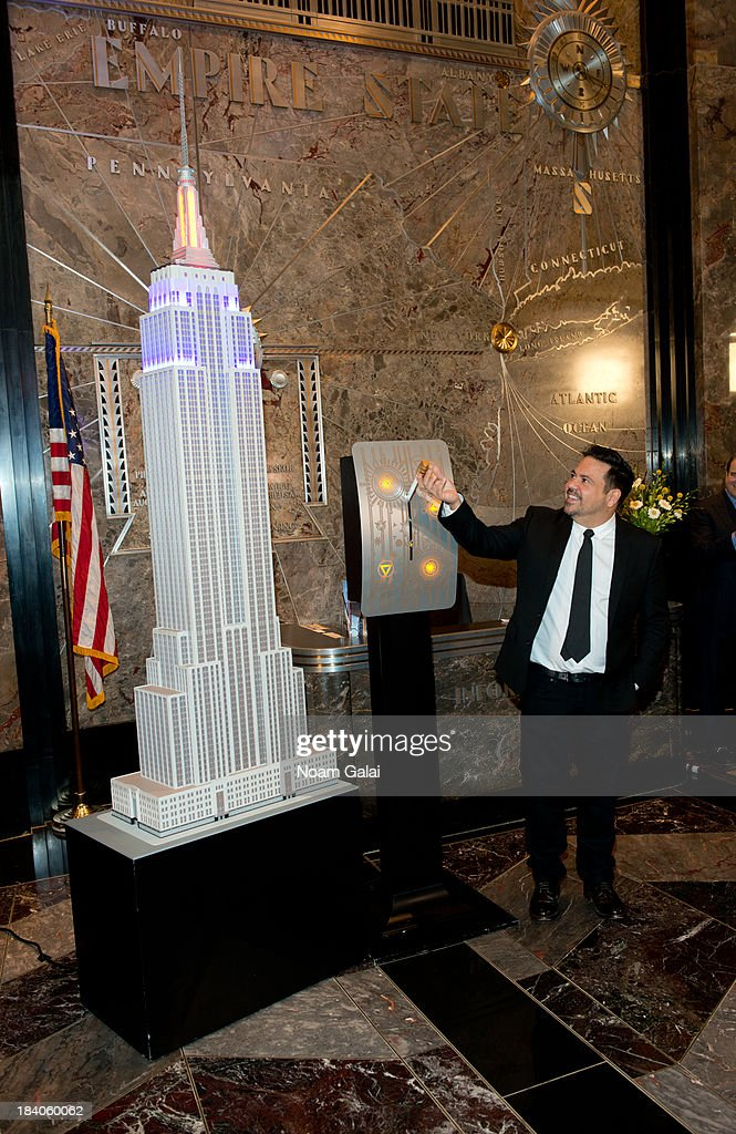 Fashion designer Narciso Rodriguez lights The Empire State Building on October 11, 2013 in New York City.