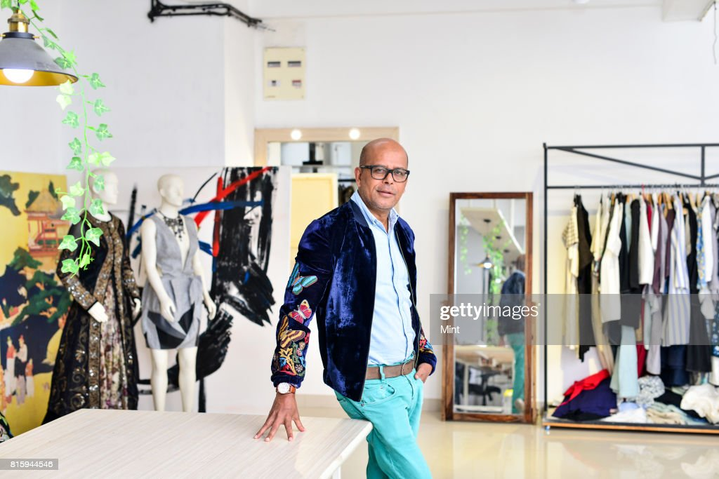 Fashion designer Narendra Kumar poses for photograph during an interview with Mint at his office in Mumbai.