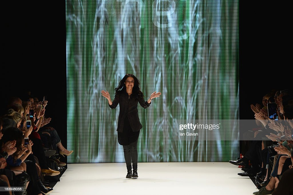 Fashion designer Nejla Guvenc walks the runway at the Nej show during Mercedes-Benz Fashion Week Istanbul s/s 2014 Presented By American Express on October 10, 2013 in Istanbul, Turkey.