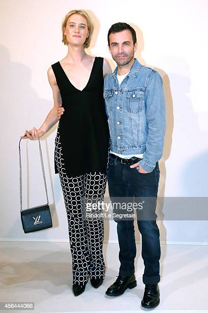 Fashion Designer Nicolas Ghesquiere and actress Mackenzie Davis pose backstage after the Louis Vuitton show as part of the Paris Fashion Week...