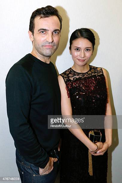 Fashion Designer Nicolas Ghesquiere and Kou Shibasaki pose backstage after the Louis Vuitton show as part of the Paris Fashion Week Womenswear...