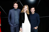 Fashion Designer Nicolas Ghesquiere standing between Model Natalia Vodianova and General manager of Berluti Antoine Arnault pose after the Louis...