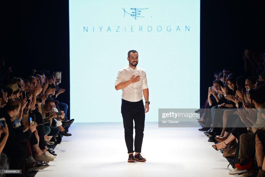 Fashion designer Niyazi Erdogan walks the runway at the Niyazi Erdogan show during Mercedes-Benz Fashion Week Istanbul s/s 2014 Presented By American Express on October 10, 2013 in Istanbul, Turkey.