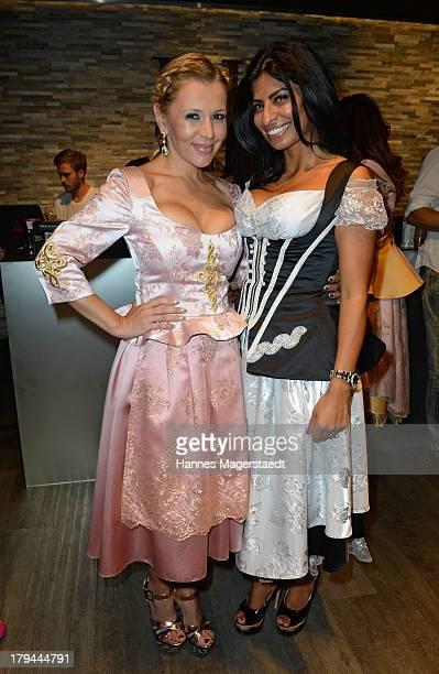 Fashion designer Noura El Massaoudi and Davorka Tovilo attend the EGB Fashion Show on September 3 2013 in Munich Germany