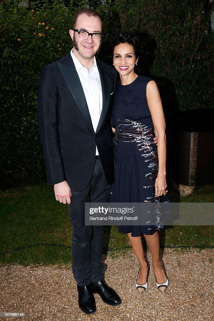 Fashion designer of Balenciaga Marco Zanin and Farida Khelfa Seydoux attend the 'Chambre Syndicale de la Haute Couture' Cocktail to celebrate the end...
