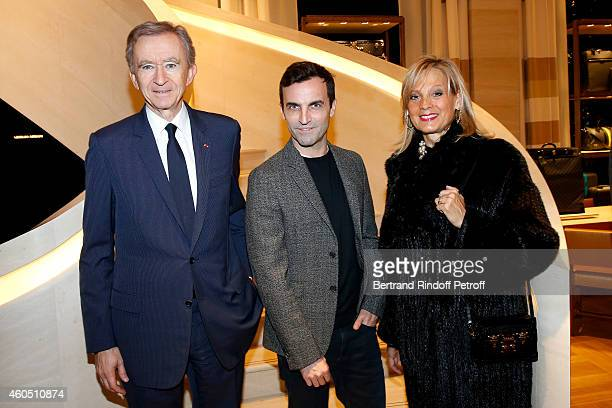 Fashion Designer of Louis Vuitton Nicolas Ghesquiere standing between Owner of LVMH Luxury Group Bernard Arnault and his wife Helene Arnault attend...