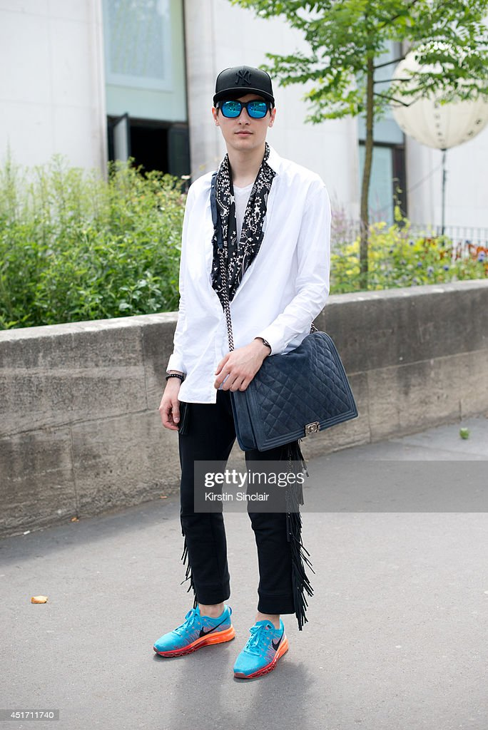 Fashion designer Oleg Moscal wearing Nike trainers, Chanel bag and scarf, KTZ trousers, Givenchy shirt, New Era cap and Lapiz sunglasses on day 3 of Paris Collections: Men on JUNE 27, 2014 in Paris, France.