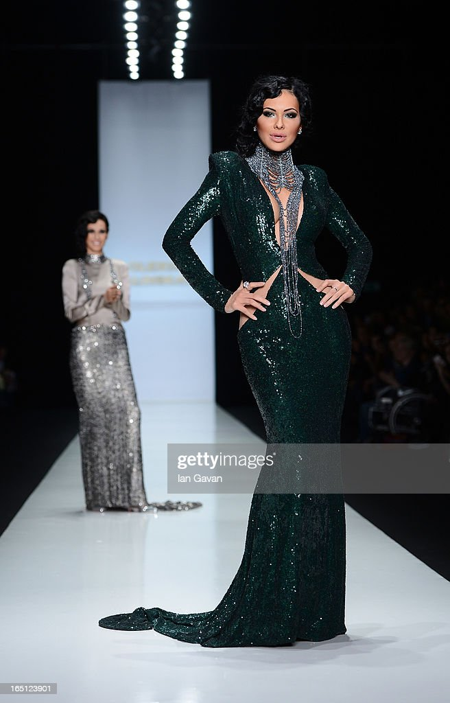 Fashion designer Olesya Malinskaya acknowledges applause following the Olesya Malinskaya show during Mercedes-Benz Fashion Week Russia Fall/Winter 2013/2014 at Manege on March 31, 2013 in Moscow, Russia.