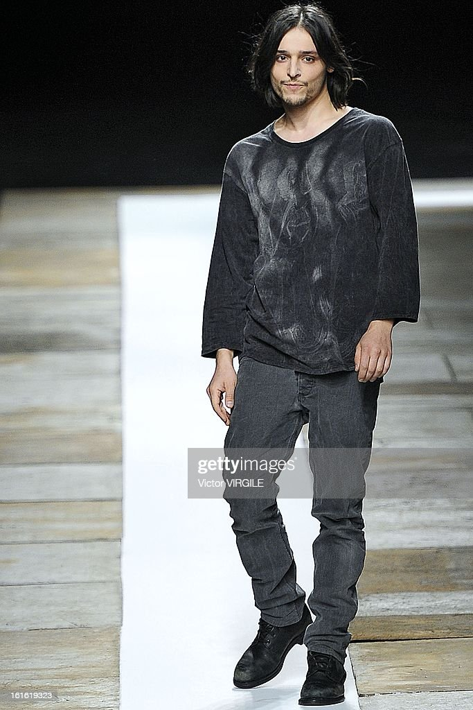 Fashion designer Olivier Theyskens walks the runway at the Theyskens' Theory Ready to Wear Fall/Winter 2013-2014 fashion show during Mercedes-Benz Fashion Week at Skylight at Moynihan Station on February 11, 2013 in New York City.