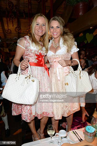 Fashion designer Ophelia Blaimer and Alessandra Geissel attend the Oktoberfest beer festival at Theresienwiese on September 21 2013 in Munich Germany