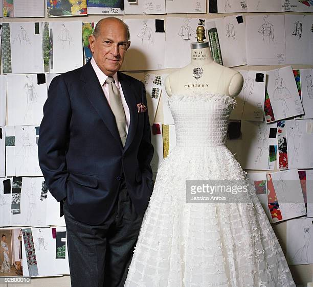 Fashion designer Oscar de la Renta in his New York design studio with one of his wedding dresses in March 2008