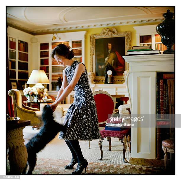 Fashion designer Oscar de la Renta's stepdaughter Eliza Bolen is photographed at home with her dog George for Vanity Fair Spain on May 7 2009 in New...