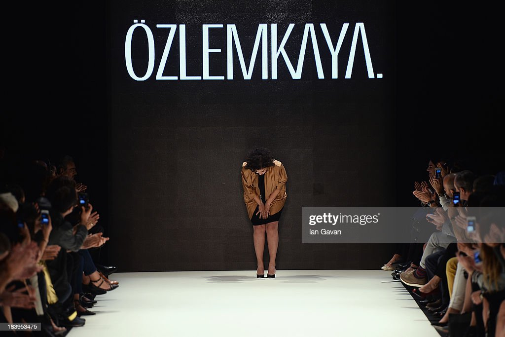 Fashion designer Ozlem Kaya walks the runway at the Ozlem Kaya show during Mercedes-Benz Fashion Week Istanbul s/s 2014 Presented By American Express on October 10, 2013 in Istanbul, Turkey.