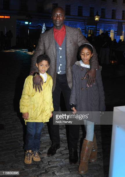 Fashion designer Ozwald Boateng and family attend the VIP opening of Skate hosted by Tiffany and Co held at Somerset House on November 16 2009 in...