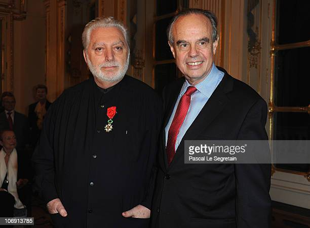 Fashion Designer Paco Rabanne poses with French Culture Minister Frederic Mitterrand after he received the Legion of Honor at Ministere de la Culture...