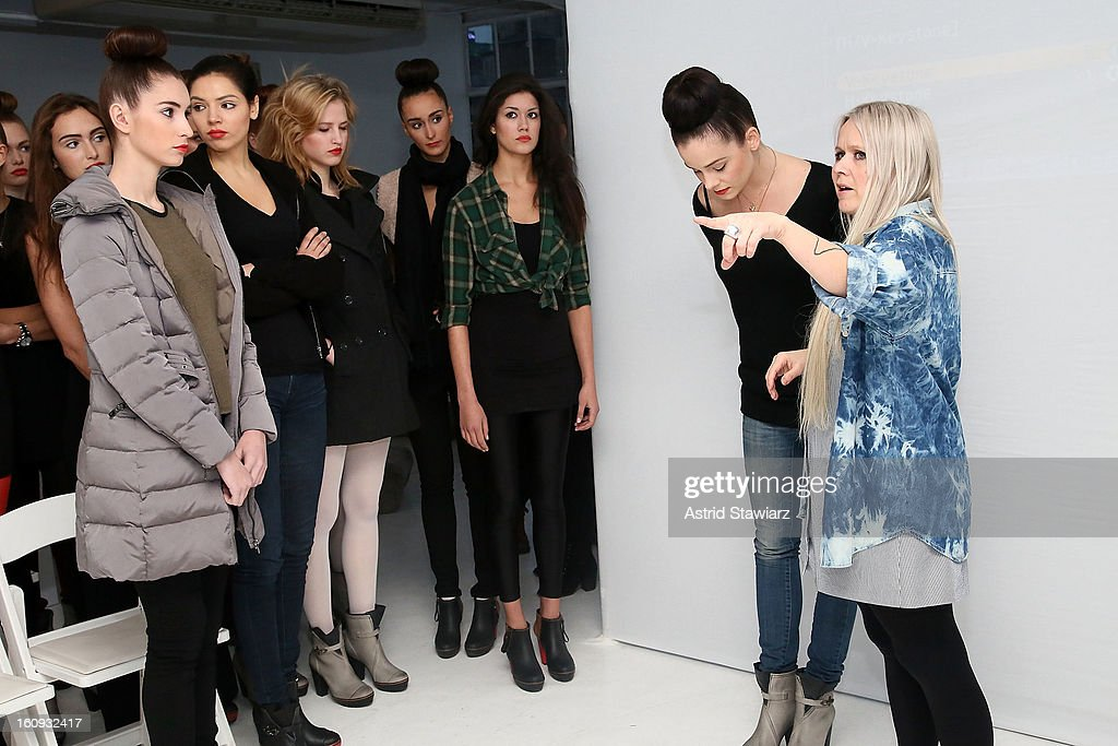 Fashion designer Paola Suhonen (R) talks to models backstage at the Ivana Helsinki fall 2013 Fashion show during Mercedes-Benz Fashion Week at Studio 450 on February 7, 2013 in New York City.