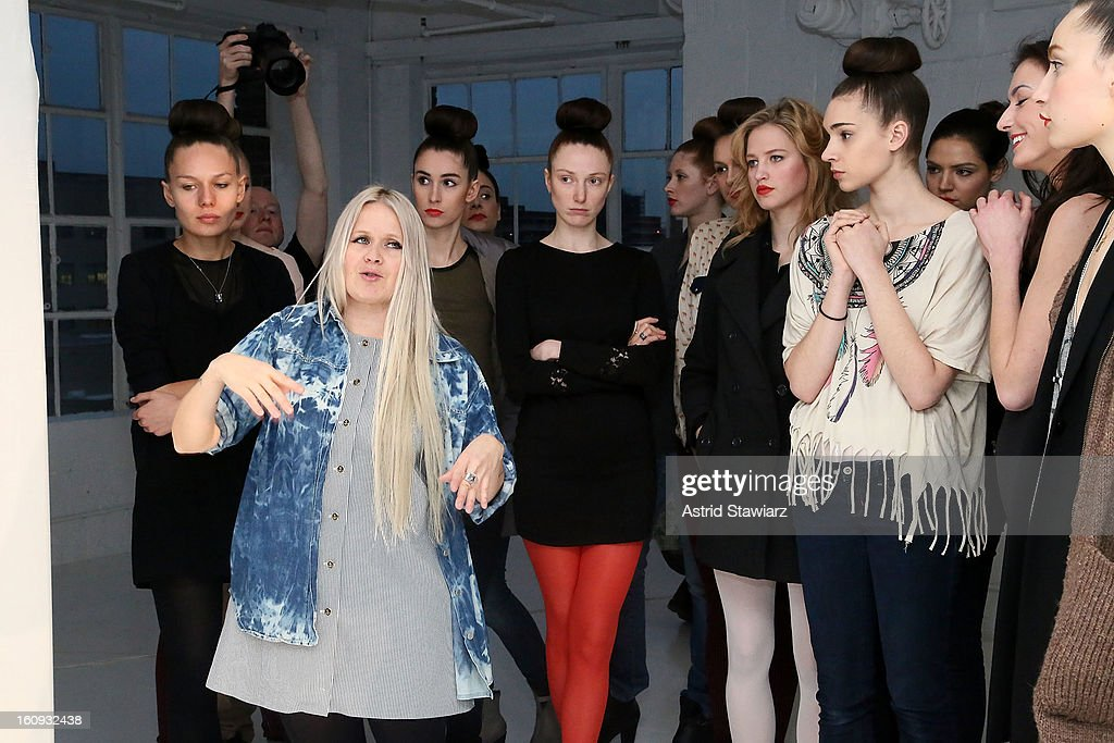 Fashion designer Paola Suhonen (L) talks to models backstage at the Ivana Helsinki fall 2013 Fashion show during Mercedes-Benz Fashion Week at Studio 450 on February 7, 2013 in New York City.