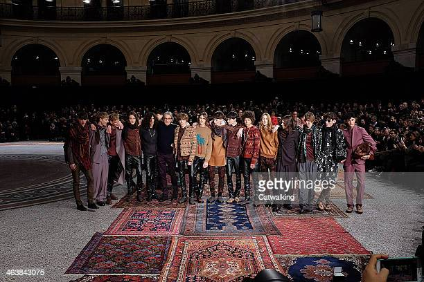 Fashion designer Paul Smith poses with models on the runway at the Paul Smith Autumn Winter 2014 fashion show during Paris Menswear Fashion Week on...