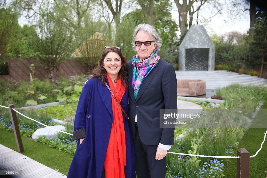 Fashion Designer, Paul Smith with Garden designer Jinny Blom in the B&Q Sentebale 'Forget-Me-Not' Garden at the Chelsea Flowert Show at the Royal Hospital Chelsea on May 20, 2013 in London, England. The B&Q Sentebale 'Forget Me Not' Garden was designed by renowned garden designer Jinny Blom and includes native Lesotho flowers and a contemporary pavilion based on a Traditional Basotho roundhouse. The garden was built to raise awareness of the work of Prince Harry's charity Sentebale and the plight of the children of this small African Kingdom.