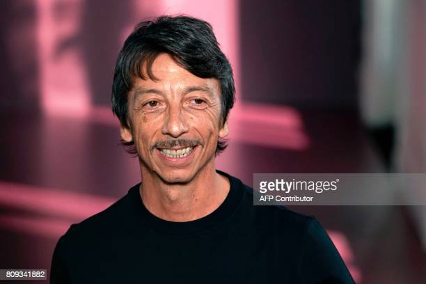 Fashion designer Pierpaolo Piccioli acknowledges the audience at the end of the Valentino 20172018 fall/winter Haute Couture collection in Paris on...