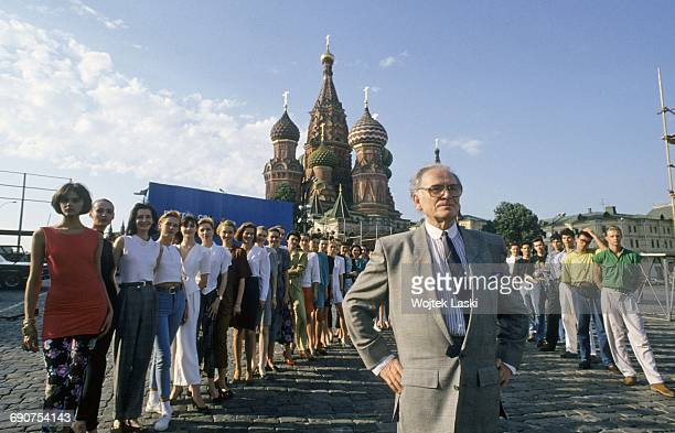 Fashion designer Pierre Cardin and his models at the Red Square in Moscow Russia in June 1991