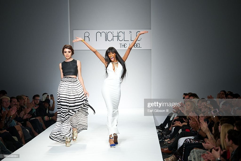 Fashion Designer Rachael Broussard walks the catwalk with one of her models to celebrate the R.Michel'le Label showing during LA Fashion Week on October 17, 2013 in Los Angeles, California.