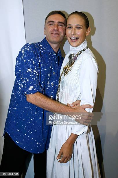 Fashion Designer Raf Simons and Actress Leelee Sobieski pose Backstage after the Christian Dior show as part of the Paris Fashion Week Womenswear...