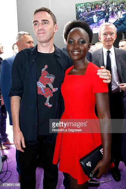 Fashion Designer Raf Simons and actress Lupita Nyong'o pose Backstage after the Christian Dior show as part of Paris Fashion Week Haute Couture...
