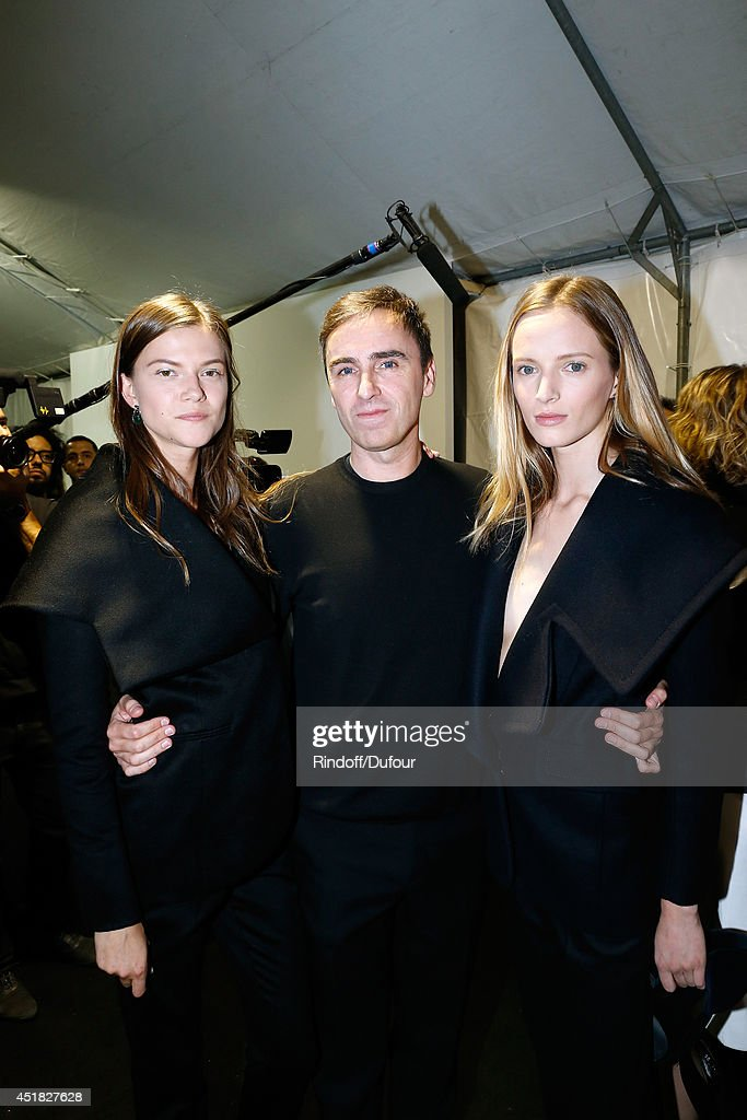 Fashion designer <a gi-track='captionPersonalityLinkClicked' href=/galleries/search?phrase=Raf+Simons+-+Fashion+Designer&family=editorial&specificpeople=7070305 ng-click='$event.stopPropagation()'>Raf Simons</a> and models pose backstage after the Christian Dior show as part of Paris Fashion Week - Haute Couture Fall/Winter 2014-2015. Held at Musee Rodin on July 7, 2014 in Paris, France.