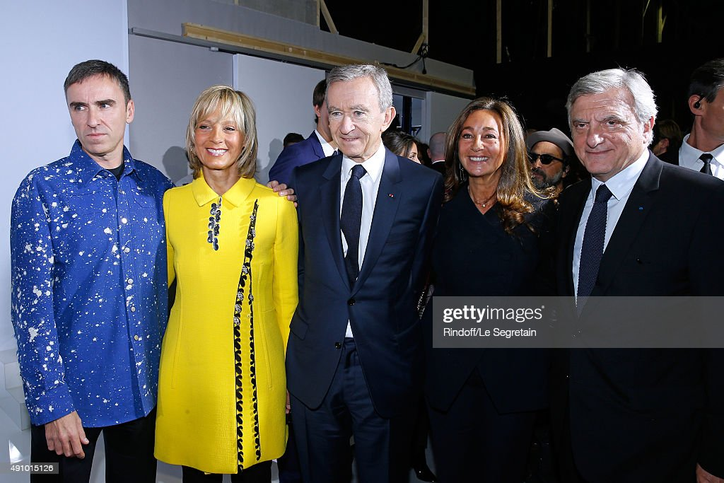 Fashion Designer Raf Simons, Owner of LVMH Luxury Group Bernard Arnault with his wife Helene Arnault and CEO Dior Sidney Toledano and his wife Katia Toledano pose Backstage after the Christian Dior show as part of the Paris Fashion Week Womenswear Spring/Summer 2016. Held at Cour Carree du Louvre on October 2, 2015 in Paris, France.