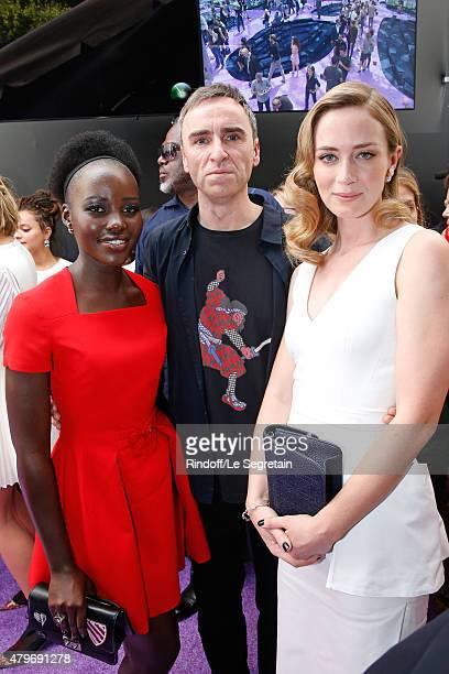 Fashion Designer Raf Simons standing between Actresses Lupita Nyong'o and Emily Blunt pose Backstage after the Christian Dior show as part of Paris...