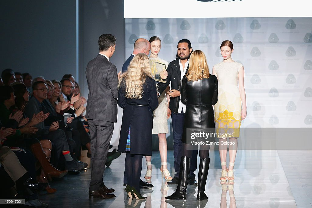 Fashion designer <a gi-track='captionPersonalityLinkClicked' href=/galleries/search?phrase=Rahul+Mishra+-+Fashion+Designer&family=editorial&specificpeople=13625080 ng-click='$event.stopPropagation()'>Rahul Mishra</a> receives his award during the International Woolmark Prize as part of Milan Fashion Week Womenswear Autumn/Winter 2014 on February 21, 2014 in Milan, Italy.