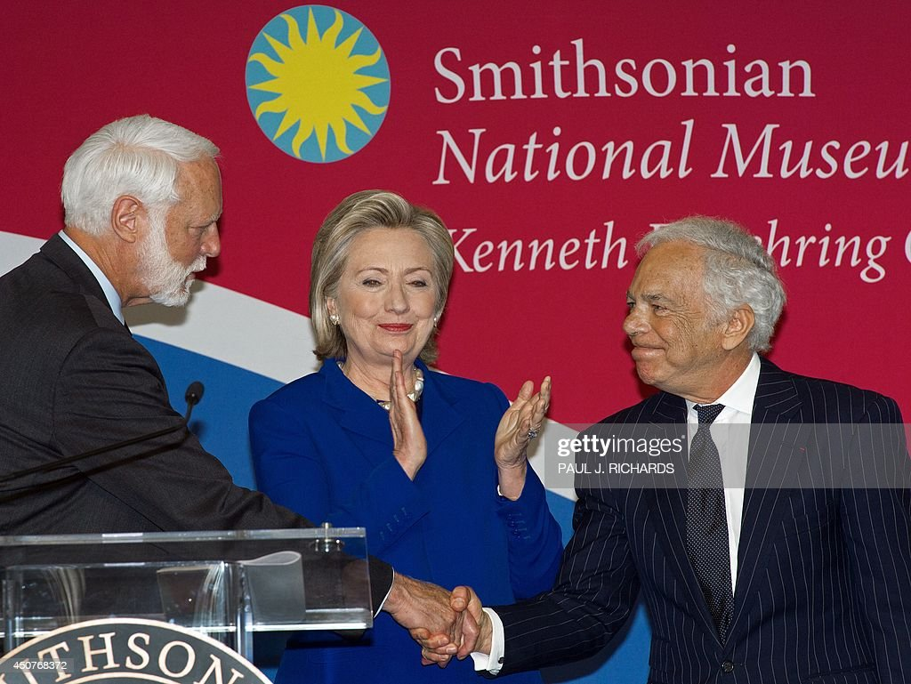 Fashion designer Ralph Lauren (R) is congratulated by Smithsonian Secretary Wayne Clough (L