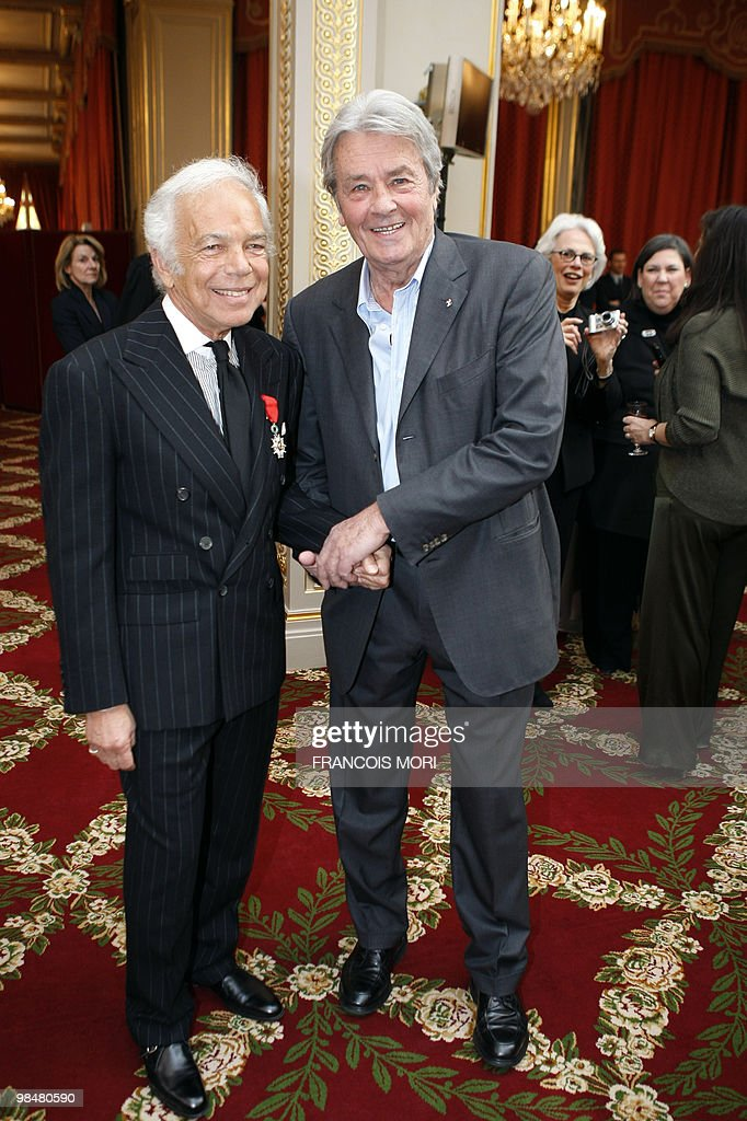 US fashion designer Ralph Lauren (L) poses with French actor Alain Delon (R