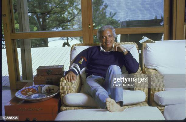 Fashion Designer Ralph Lauren relaxed and sitting on couch in his home