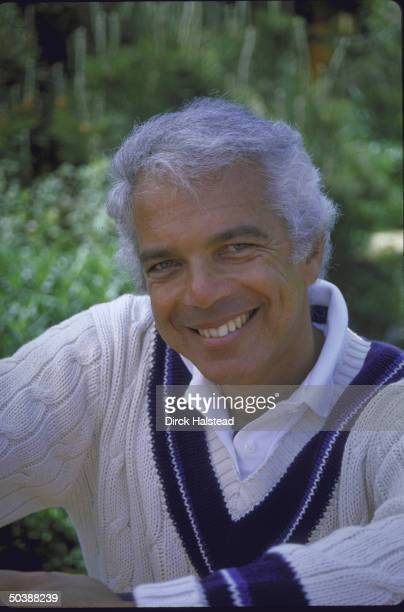 Fashion Designer Ralph Lauren sitting outdoors
