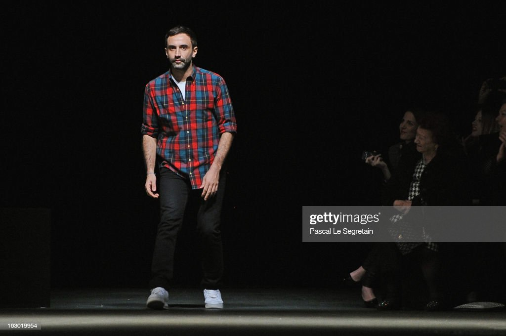 Fashion designer Riccardo Tisci acknowledges applause foolowing the Givenchy Fall/Winter 2013 Ready-to-Wear show as part of Paris Fashion Week on March 3, 2013 in Paris, France.