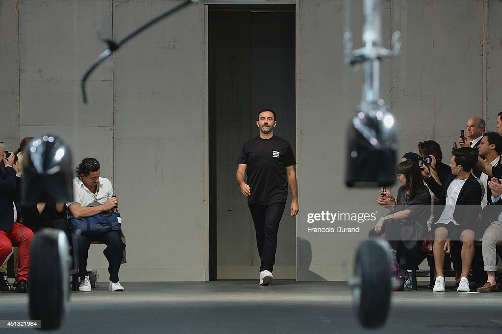 Fashion designer <a gi-track='captionPersonalityLinkClicked' href=/galleries/search?phrase=Riccardo+Tisci&family=editorial&specificpeople=2214975 ng-click='$event.stopPropagation()'>Riccardo Tisci</a> acknowledges the applause of the audience after the Givenchy show as part of the Paris Fashion Week Menswear Spring/Summer 2015 on June 27, 2014 in Paris, France.
