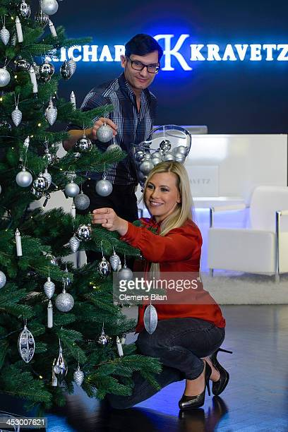 Fashion designer Richard Kravetz and TV host Nadine Krueger pose during a photo session in front of a christmas tree on December 01 2013 in Berlin...