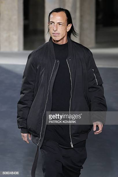 US fashion designer Rick Owens acknowledges the crowd after his fashion show during the men's Fashion Week for the 20162017 Fall/Winter collection in...