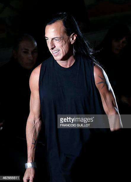 US fashion designer Rick Owens acknowledges the public at the end of his Fall/Winter 20142015 men's fashion show in Paris on January 16 2014 AFP...