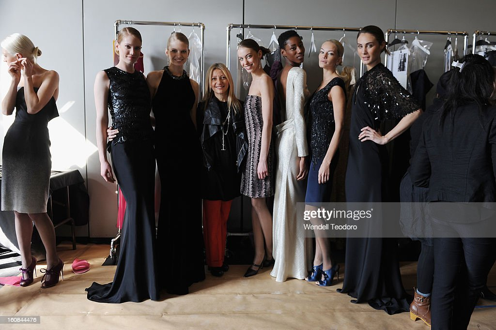 Fashion Designer Rita Vinieris and her models pose backstage before the Rita Vinieris Debut Eveningwear Collection presentation during Fall 2013 Mercedes-Benz Fashion Week at the Baryshnikov Arts Center on February 6, 2013 in New York City.