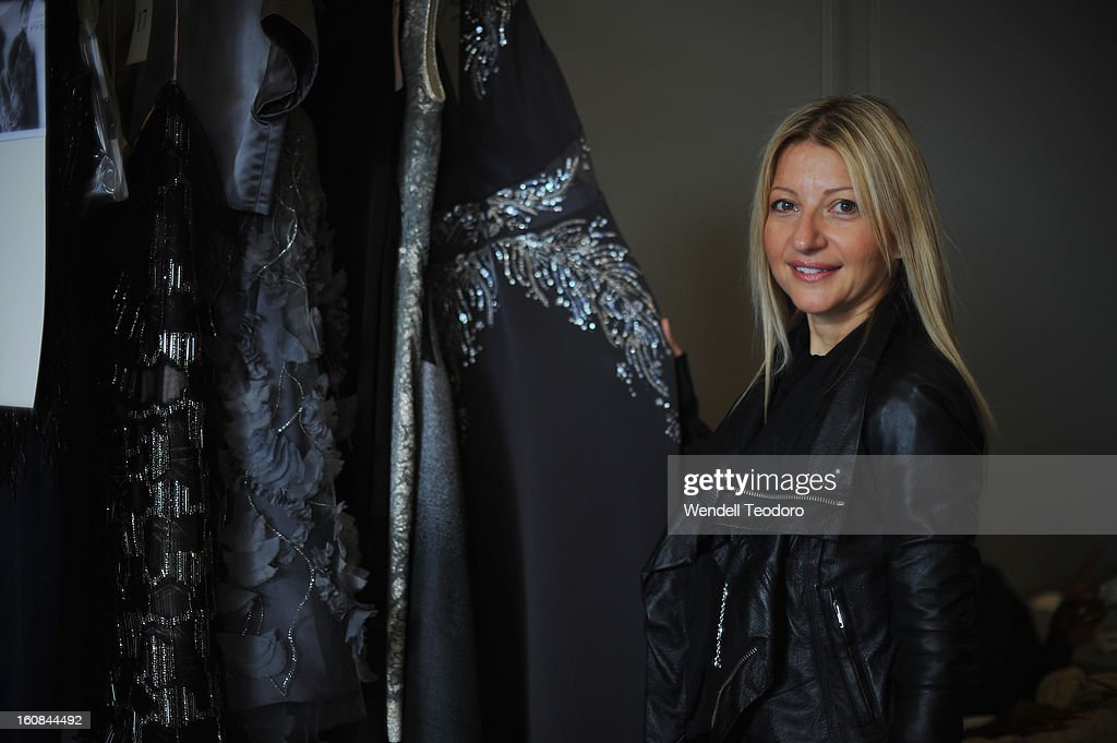 Fashion Designer Rita Vinieris prepares backstage before the Rita Vinieris Debut Eveningwear Collection presentation during Fall 2013 Mercedes-Benz Fashion Week at the Baryshnikov Arts Center on February 6, 2013 in New York City.