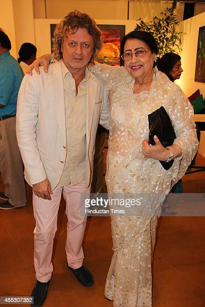 Fashion designer Rohit Bal with a guest at filmmaker Anu Malhotra's debut art show Hue Borne at Visual Arts Gallery India Habitat Centre on September...