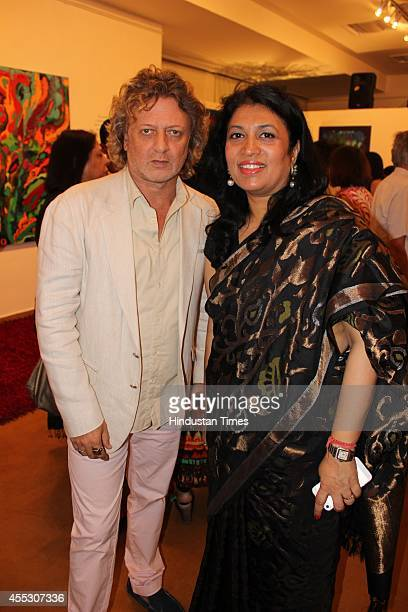 Fashion designer Rohit Bal with gallerist Sunaina Anand at filmmaker Anu Malhotra's debut art show Hue Borne at Visual Arts Gallery India Habitat...