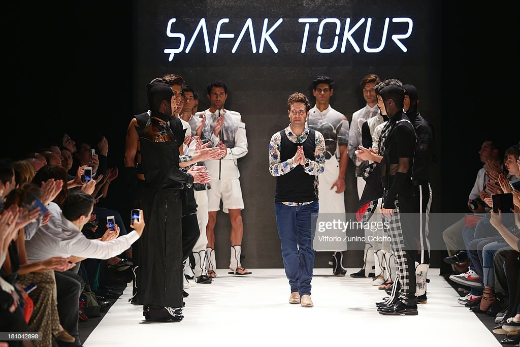 Fashion designer Safak Tokur walks the runway at the Safak Tokur show during Mercedes-Benz Fashion Week Istanbul s/s 2014 Presented By American Express on October 11, 2013 in Istanbul, Turkey.