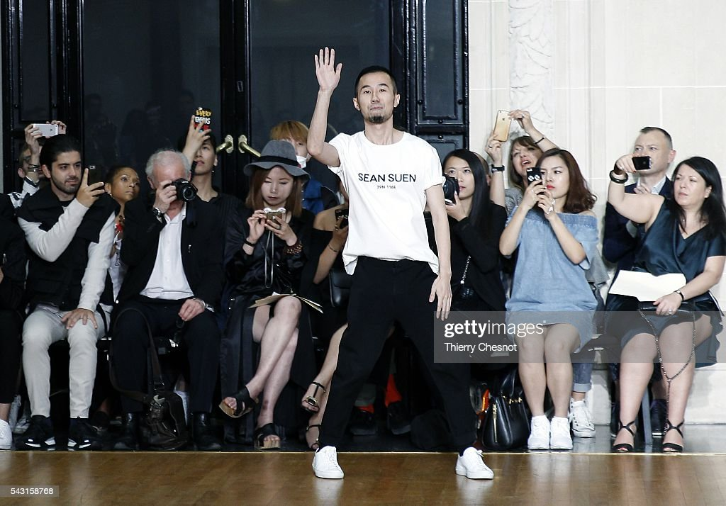 Fashion designer Sean Suen acknowledges the applause of the public after the Sean Suen Menswear Spring/Summer 2017 show as part of Paris Fashion Week on June 26, 2016 in Paris, France.